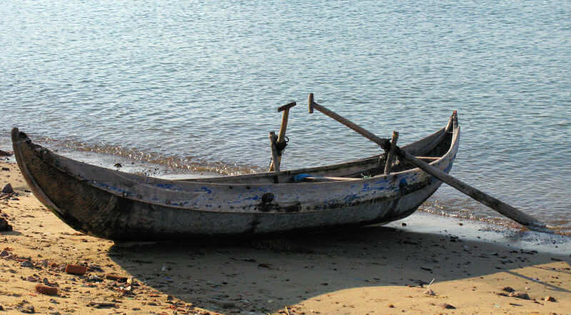 Composite wood and woven bamboo boat on beach
